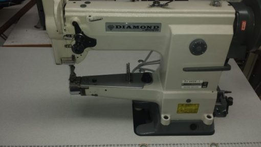 Walking foot, cylinder arm machine. Ideal for heavier materials and leather. Large bobbin.